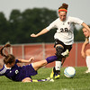 9-13-12<br /> WHS vs NWHS soccer<br /> Western's Madi Trueblood gains possession of the ball after Northwestern's Kaitlynd Lear falls during the soccer game on Thursday.<br /> KT photo | Kelly Lafferty