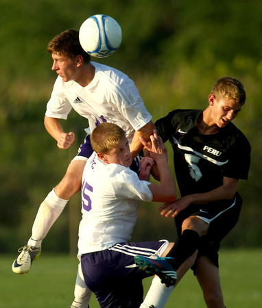 9-4-12<br /> Boys Northwestern Vs Peru HS soccer<br /> NW's Robert Olsen and Jacob Wagner battling out an airball with Peru's Conner Quin.<br /> KT photo | Tim Bath