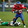 9-14-12<br /> Kokomo vs. New Castle football<br /> Kokomo's Jordan Rawlins breaks free from the hold of a New Castle defender during the football game on Friday.<br /> KT photo | Kelly Lafferty