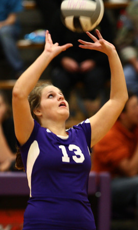 9-19-12<br /> Northwestern volleyball vs Peru<br /> Northwestern's Emily Harshman sets the ball during the game against Peru on Wednesday. Peru won the game in four sets.<br /> KT photo | Kelly Lafferty