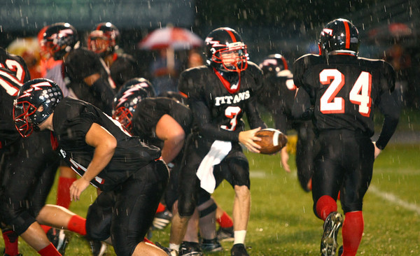 9-21-12 <br /> Dayne Tomlinson handing the ball off to Andrew Trublood duing the one play that they got off before the rain delay.<br /> KT photo | Tim Bath