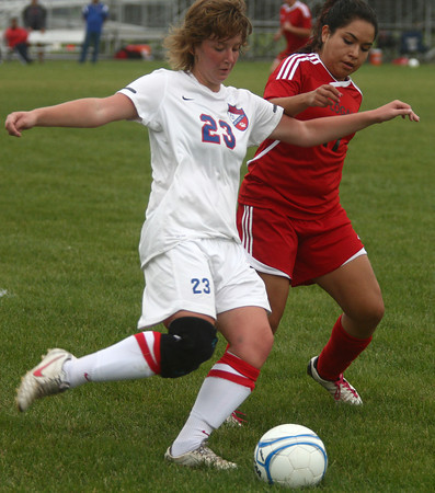 9-25-12<br /> Kokomo vs Logansport soccer<br /> Spencer Wesche of Kokomo and America Perez of Logansport fight over possession of the ball during the soccer game on Tuesday.<br /> KT photo | Kelly Lafferty