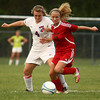9-25-12<br /> Kokomo vs Logansport soccer<br /> Kokomo High School's Breanna Kinder and Logansport's Whitney Jennings fight for control of the ball during the soccer game on Tuesday.<br /> KT photo | Kelly Lafferty