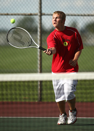 9-18-12<br /> Taylor Tennis<br /> Cole Schroeder, 3 singles for Taylor, plays a tennis match against Northwestern on Tuesday afternoon.<br /> KT photo | Kelly Lafferty