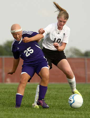 9-13-12<br /> WHS vs NWHS soccer<br /> Northwestern's Abby Webster and Western's Emily Hawkins fight for control of the ball during the soccer game on Thursday.<br /> KT photo | Kelly Lafferty