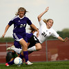 9-13-12<br /> WHS vs NWHS soccer<br /> Northwestern's Abby Burns goes for a kick as Holly Granfield of Western starts to fall during the soccer game on Thursday.<br /> KT photo | Kelly Lafferty