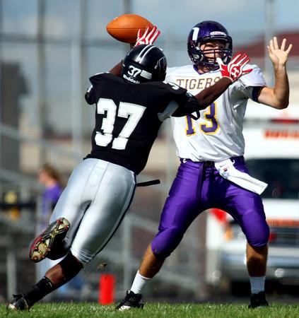 9-8-12<br /> Western HS vs Northwestern HS Football<br /> Western's James Davis putting pressure on quarterback Trevor Richmond in the first quarter but the pass was incomplete.<br /> KT photo | Tim Bath