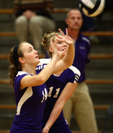 9-19-12<br /> Northwestern volleyball vs Peru<br /> Kelsey Richards, left, and Hannah Ballard keep their eyes on the ball during the game against Peru on Wednesday. Peru won the game in four sets.<br /> KT photo   Kelly Lafferty