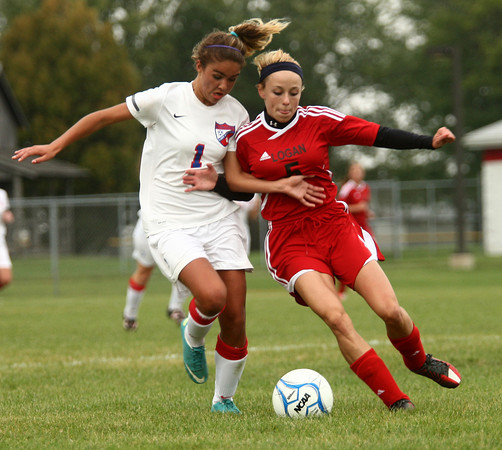 9-25-12<br /> Kokomo vs Logansport soccer<br /> Kokomo High School's Cheyenne Eltringham and Logansport's Ashley Spear battle over who will gain control of the soccer ball during the game on Tuesday.<br /> KT photo | Kelly Lafferty