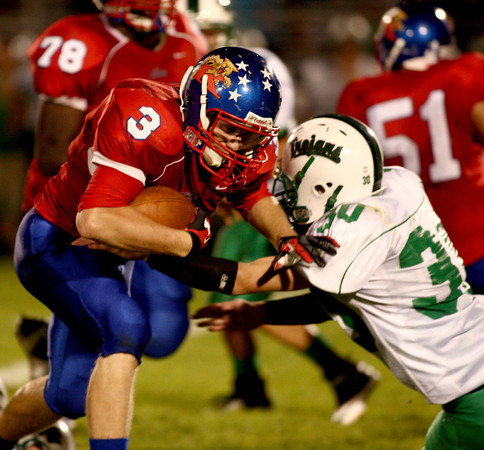 9-14-12<br /> Kokomo vs. New Castle football<br /> Kokomo's Bo Baker tries to push off New Castle's Anthony Moore during the third quarter of the Friday night football game.<br /> KT photo | Kelly Lafferty