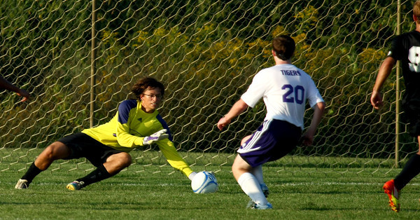 9-4-12<br /> Boys Northwestern Vs Peru HS soccer<br /> NW'S Goalie Nathan Daanen making a save on a shot from Peru's Colin Quin.<br /> KT photo | Tim Bath