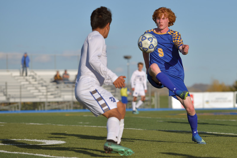 Matthew Gaston | The Sheridan Press<br>Sheridan's Wade Jacobs (9) takes control of the ball in mid air during play against Thunder Basin Friday, May 3, 2019.