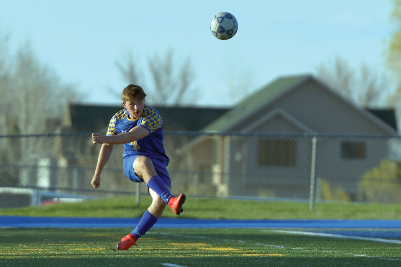 Matthew Gaston | The Sheridan Press<br>Sheridan's Quinn Heyneman (3) clears the ball out of the back field against Thunder Basin Friday, May 3, 2019.