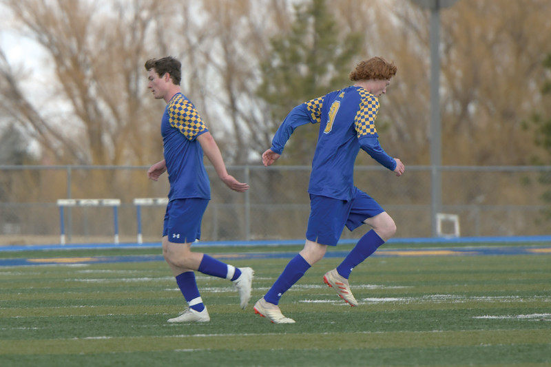 Matthew Gaston | The Sheridan Press<br>Sheridan's Toby Jacobs (2) high fives Wade Jacobs (9) in passing during a substitution Saturday, March 30, 2019.