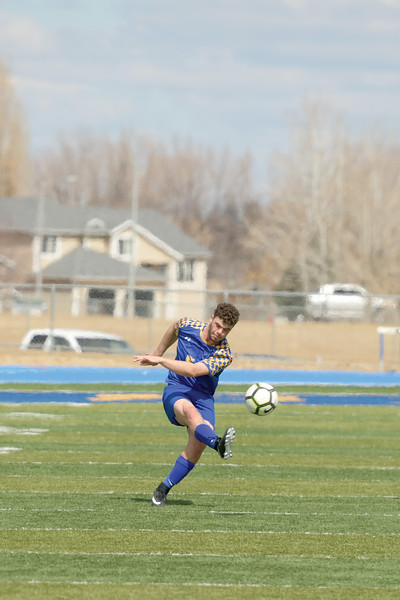Matthew Gaston | The Sheridan Press<br>Sheridan's Garret Coon (5) boots the ball across the field on free kick Saturday, March 30, 2019.