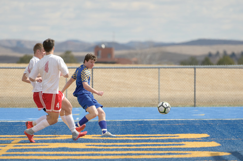Matthew Gaston | The Sheridan Press<br>Sheridan's Toby Jacobs (2) beats the defenders and fires off a shot at Homer Scott Field Saturday, March 30, 2019.