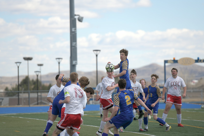 Matthew Gaston | The Sheridan Press<br>Sheridan's Ethan Rickett (11) goes for a header during a corner kick against Cheyenne Central Saturday, March 30, 2019.