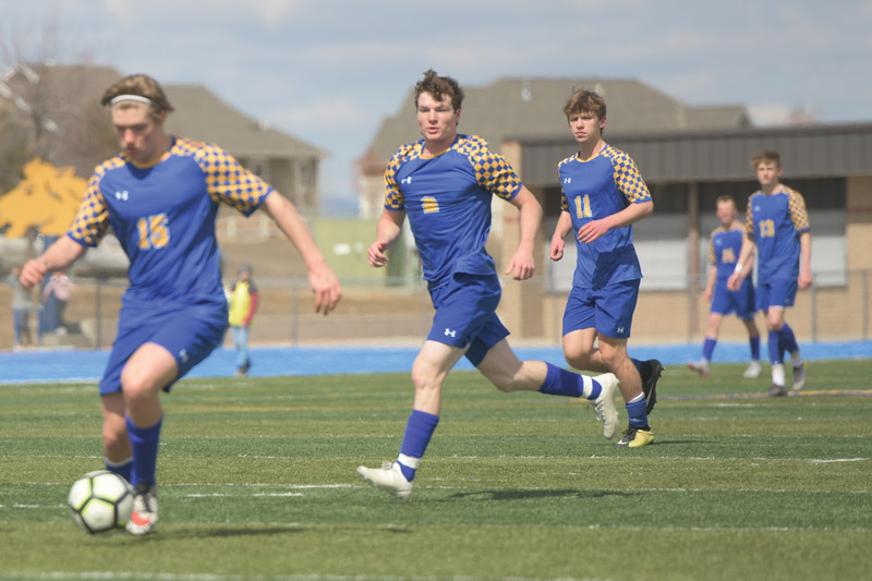 Matthew Gaston | The Sheridan Press<br>Sheridan's Toby Jacobs (2) and Ethan Rickett (11) follow the action as Tristan Bower (15) dribbles up the pitch at Homer Scott Field Saturday, March 30, 2019.