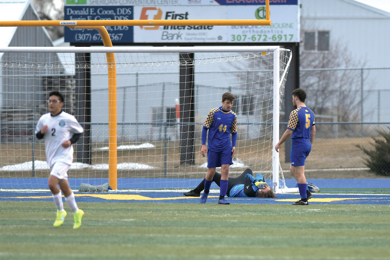 Matthew Gaston | The Sheridan Press<br>Sheridan goalkeeper Sam Salyards claps his hands to his face in frustration after Cheyenne East scored their second goal of the evening Friday, March 29, 2019.