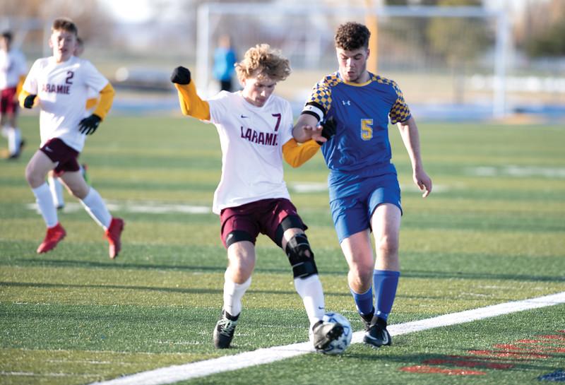Matthew Gaston | The Sheridan Press<br>Sheridan's Garrett Coon (5) makes a run up the pitch from the back field against Laramie at Homer Scott Field Friday, April 12, 2019. The Broncs beat the Laramie Plainsmen 3-nihil.
