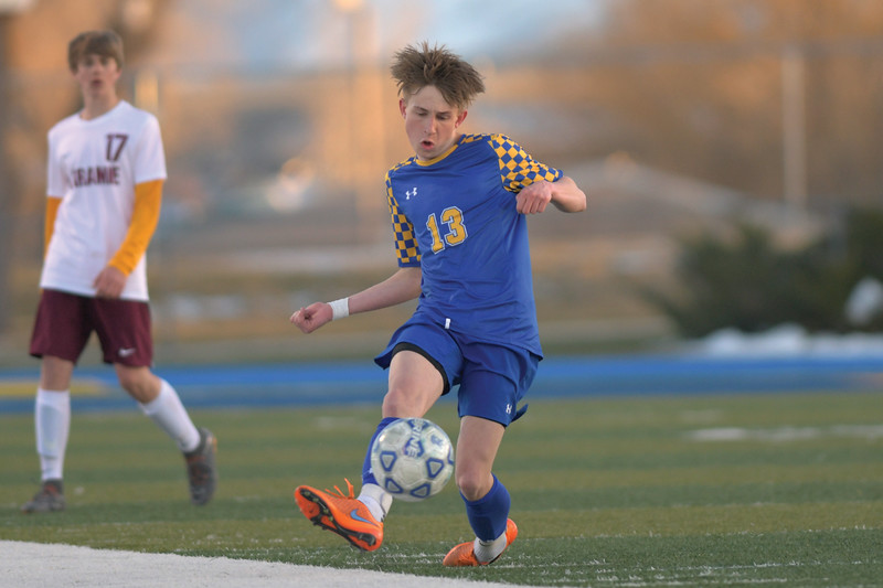Matthew Gaston | The Sheridan Press<br>Sheridan's Carter Wells (13) clears the ball up the pitch during play against Laramie Friday, April 12, 2019. The Broncs beat the Laramie Plainsmen 3-nihil.