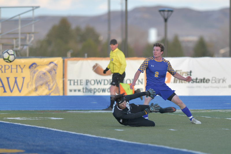 Matthew Gaston | The Sheridan Press<br>Sheridan's Toby Jacobs (2) chips a well placed shot over Laramie's goalkeeper to score his second goal of the night Friday, April 12, 2019. The Broncs beat the Laramie Plainsmen 3-nihil.