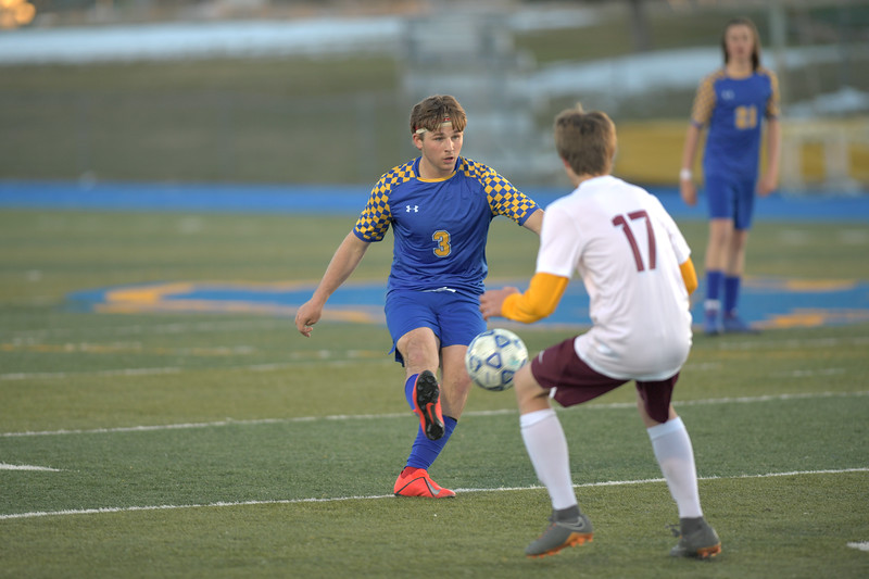 Matthew Gaston | The Sheridan Press<br>Sheridan's Quinn Heyneman (3) clears the ball into the center during play against Laramie Friday, April 12, 2019. The Broncs beat the Laramie Plainsmen 3-nihil.