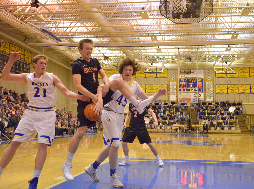 Justin Sheely | The Sheridan Press<br /> Billings Senior High School's Braxton Haws, center, rebounds over Sheridan's Parker Christensen (21) and Samuel Lecholat (45) at Sheridan High School Friday, Jan. 12, 2018. Sheridan boys lost to Billings Senior High School 56-45.