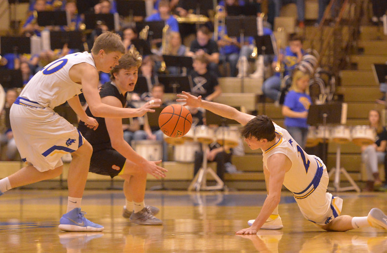 Justin Sheely | The Sheridan Press<br /> Sheridan's Gus Wright, left, and Aaron Sessions, right, steal the ball from Billings Senior High School's Max Evenson at Sheridan High School Friday, Jan. 12, 2018. Sheridan boys lost to Billings Senior High School 56-45.