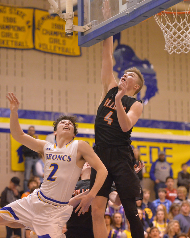 Justin Sheely | The Sheridan Press<br /> Billings Senior High School's Slade Cobb, right, blocks a layup from Sheridan's Aaron Sessions at Sheridan High School Friday, Jan. 12, 2018. Sheridan boys lost to Billings Senior High School 56-45.
