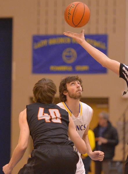 Justin Sheely | The Sheridan Press<br /> Sheridan's Aaron Woodward, right, and Billings Senior High School's Brooks Zimmer eye the ball for the tipoff at Sheridan High School Friday, Jan. 12, 2018. Sheridan boys lost to Billings Senior High School 56-45.