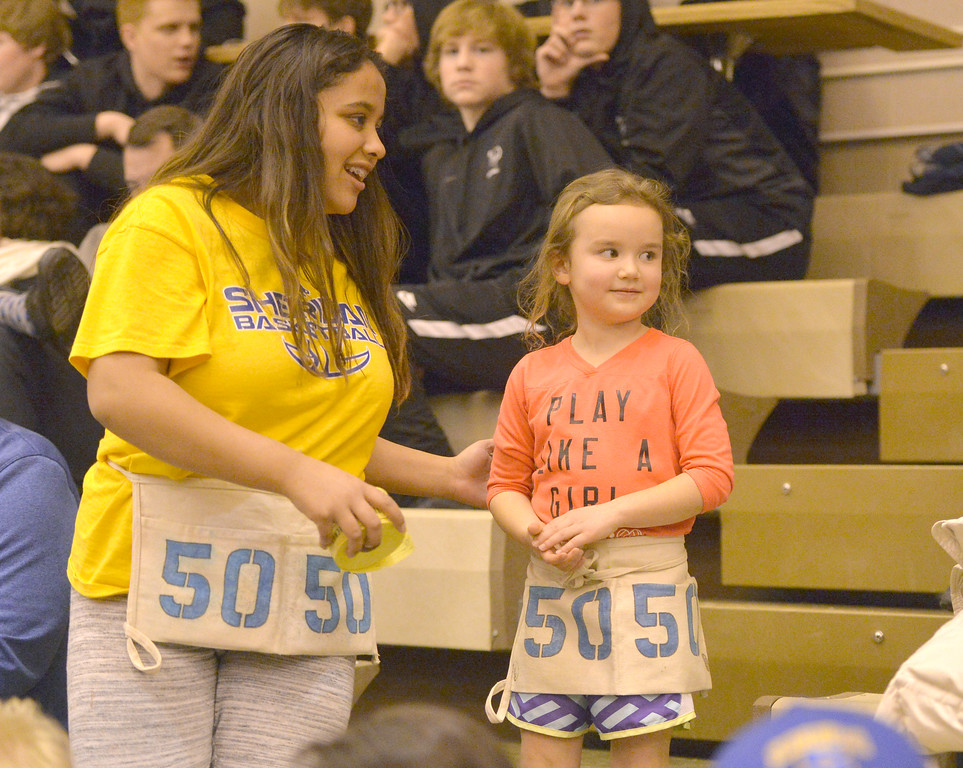 Justin Sheely | The Sheridan Press<br /> Eighth-grader Marianna Ketcham, left ,and Claire Mowry, 8, sell 50/50 raffle tickets during the game against Billings Senior at Sheridan High School Friday, Jan. 12, 2018. Sheridan boys lost to Billings Senior High School 56-45.