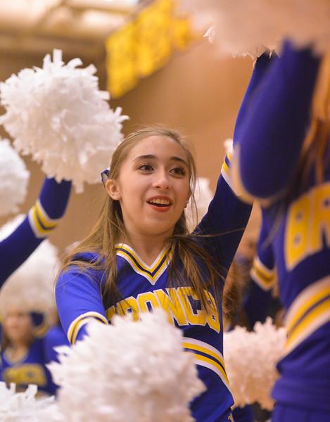 Justin Sheely | The Sheridan Press<br /> Sheridan cheerleader member Kimberly Solti cheers during the Broncs game against Billings Senior at Sheridan High School Friday, Jan. 12, 2018. Sheridan boys lost to Billings Senior High School 56-45.