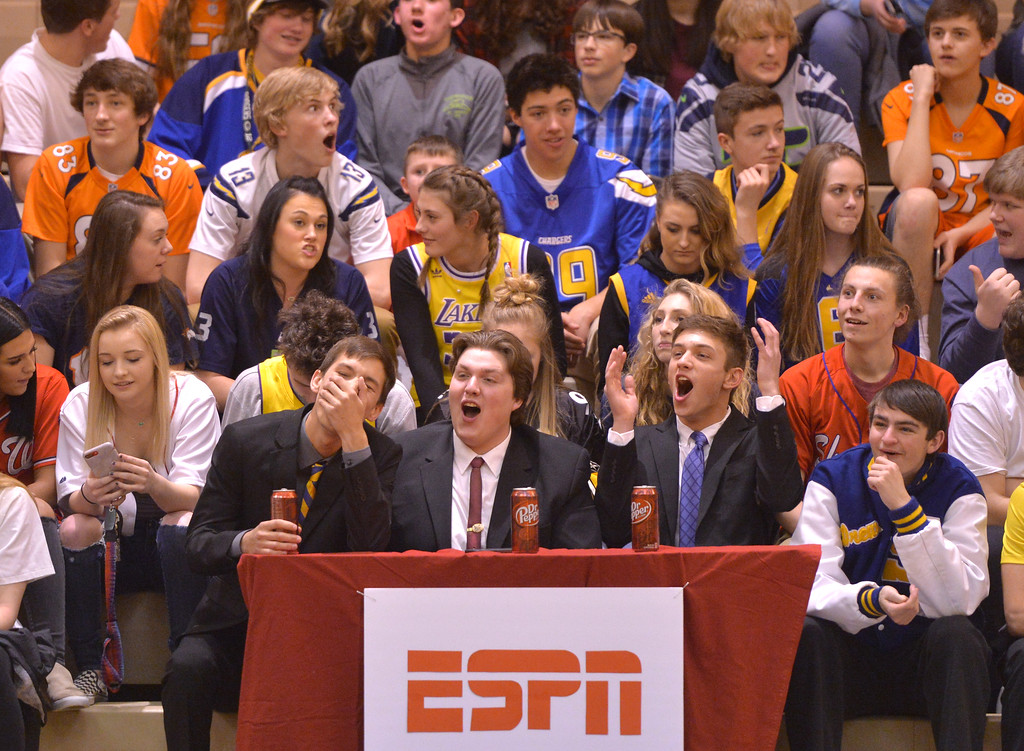 "Justin Sheely | The Sheridan Press<br /> Sheridan students, from left, Bridger Gransbery, Robert Welborn and Isaiah Rice sit behind their ""ESPN Desk"" during the game against Billings Senior at Sheridan High School Friday, Jan. 12, 2018. Sheridan boys lost to Billings Senior High School 56-45."