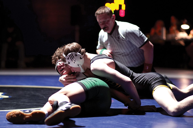 Matthew Gaston | The Sheridan Press<br>Sheridan's Rudy Osborne manuevers his opponent to his back during the dual against Kelly Walsh Thursday, Feb. 6, 2020.