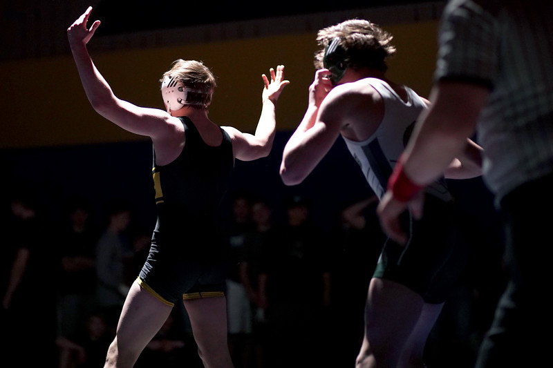Matthew Gaston | The Sheridan Press<br>Sheridan's Hunter Goodwin raises his hands in victory, Goodwin was down on points but managed to pin Kelly Walsh's Garrett Marker Thursday, Feb. 6, 2020.