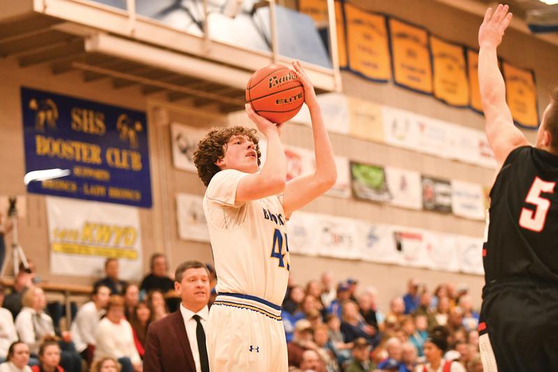 Matthew Gaston   The Sheridan Press<br>Sheridan High School's Sam Lecholat (45) shoots for three Friday, Feb. 1, 2019. The Broncs won 73-56.