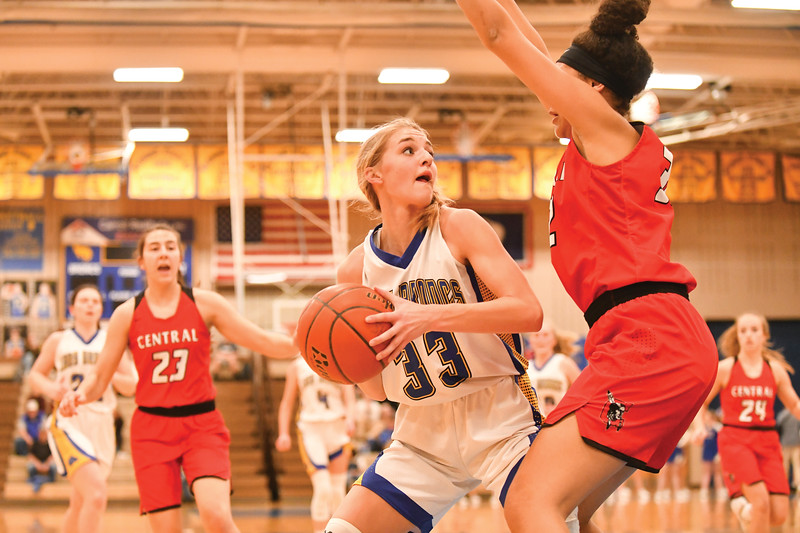 Matthew Gaston | The Sheridan Press<br>Sheridan High School's Katie Ligocki (33) tries to make space for a shot in the paint Friday, Feb. 1, 2019. Sheridan lost to Cheyenne Central 35-69.