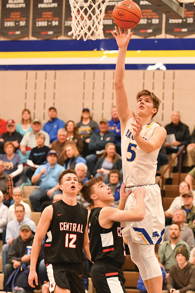 Matthew Gaston | The Sheridan Press<br>The Broncs' Gus Wright (5) soars above the defense to knock down an easy two point jumper Friday, Feb. 1, 2019. Sheridan defeated Cheyenne Central 73-56.