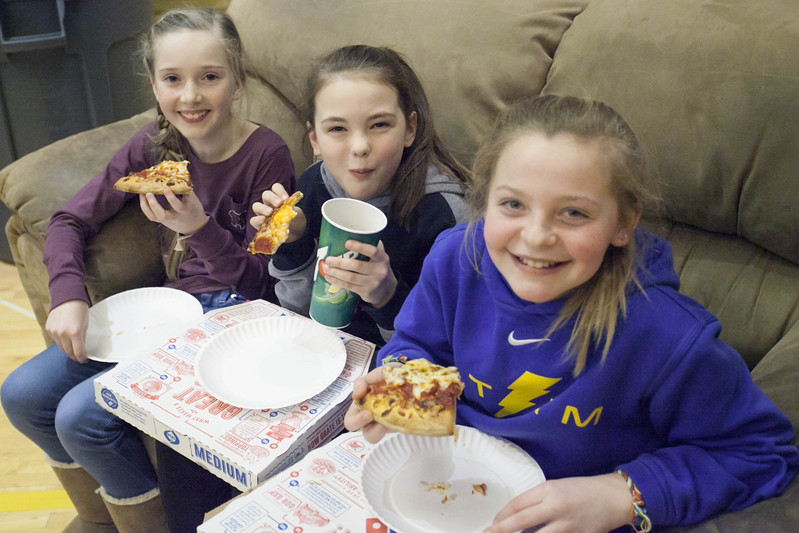 "Tibby McDowell | The Sheridan Press<br /> <br /> Ella Bilyeu, left, Avery Vonkrosigk, center, and Chelsie Morris were the winners of the ""best seat of the house"" and pizza during the Broncs basketball game at Sheridan High School Friday Feb. 9, 2018."