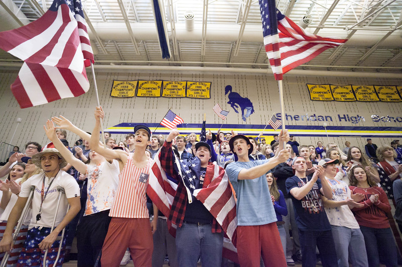 Tibby McDowell | The Sheridan Press<br /> <br /> Sheridan Bronc student cheering section dressed in red, white, & blue and waved flags for the basketball games against Cheyenne Central at Sheridan High School Friday Feb. 9, 2018.