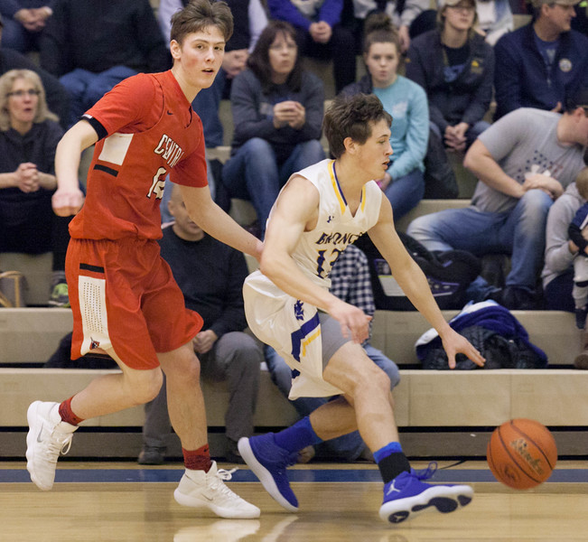 Tibby McDowell | The Sheridan Press<br /> <br /> Noah Erickson sweeps past a Cheyenne Central defender on his way to the basket at Sheridan High School Friday Feb. 9, 2018.