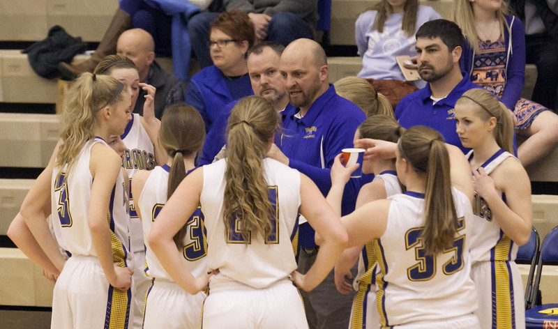 Tibby McDowell | The Sheridan Press<br /> <br /> Lady Broncs coach Larry Ligocki talks to his team during a time-out against Cheyenne Central at Sheridan High School Friday Feb. 9, 2018.