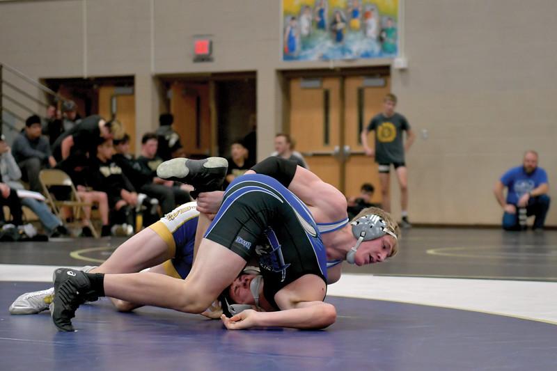 Matthew Gaston | The Sheridan Press<br>Sheridan's Brock Steel rolls his opponent over for the pin during Border Wars Saturday, Jan. 18, 2020.