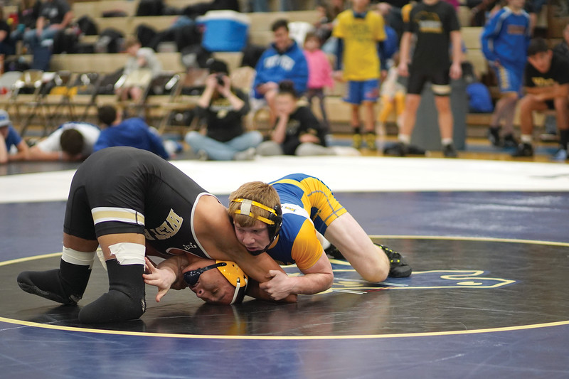 Matthew Gaston | The Sheridan Press<br>Sheridan's Reese Osborne reaches underneath to secure a leg during the dual against West at Border Wars Saturday, Jan. 18, 2020.