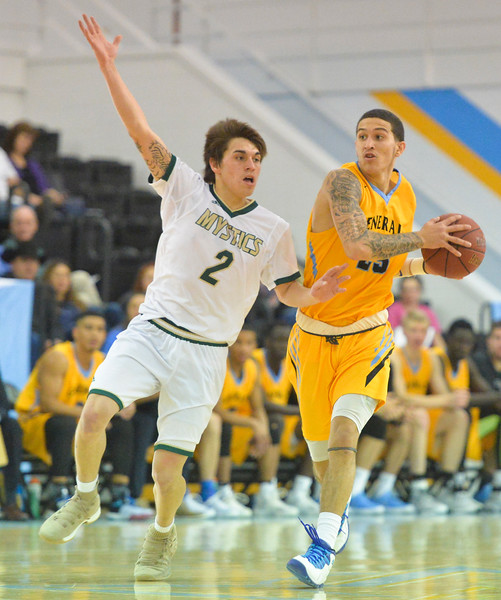 Justin Sheely | The Sheridan Press	<br /> Sheridan's Caleb Stewart moves against Bismarck State College's Dante Fischer during the Holiday Inn Tournament Saturday at the Bruce Hoffman Golden Dome.
