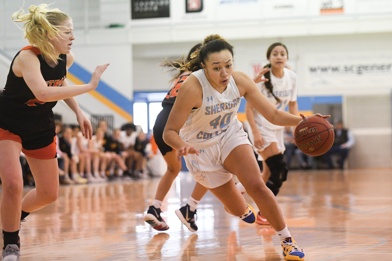 Matthew Gaston   The Sheridan Press<br>Sheridan College's Misini Fifita (40) drives the lane against Central Wyoming College at the Bruce Hoffman Golden Dome Saturday, Feb. 16, 2019.