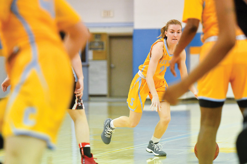 Matthew Gaston | The Sheridan Press<br>Sheridan College's Haley McDermott (25) slows down the pace at the top of the key so teammates can get set up at the Bruce Hoffman Golden Dome Wednesday, Feb. 6, 2019.