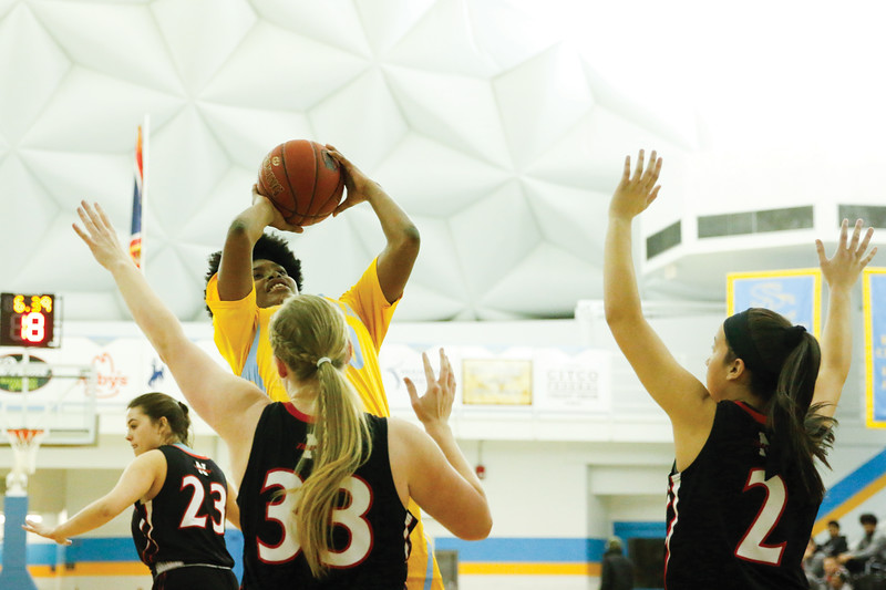 Matthew Gaston | The Sheridan Press<br>Sheridan College's Cynthia Green (30) hits the fade away jump shot under pressure from Northwest at the Bruce Hoffman Golden Dome Wednesday, Feb. 6, 2019. The Lady Generals won 50-45.