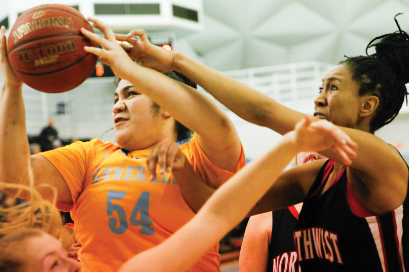 Matthew Gaston | The Sheridan Press<br>Sheridan College's Lani Taliauli (54) is swarmed by Nrthwest uder the basket at the Bruce Hoffman Golden Dome Wednesday, Feb. 6, 2019.